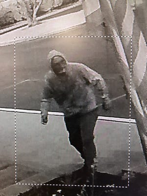 A surveillance photo of a man the sheriff's department belives is involved in a flag burning vandalism at the Accelerated Charte High School campus north of Tulare.