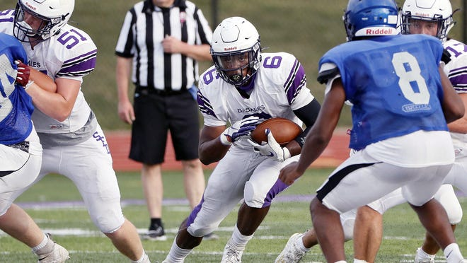 DeSales running back Quintell Quinn, carrying the ball against Hilliard Bradley during a scrimmage Friday, rushed for 1,808 yards last season. He's also a standout linebacker for the Stallions.
