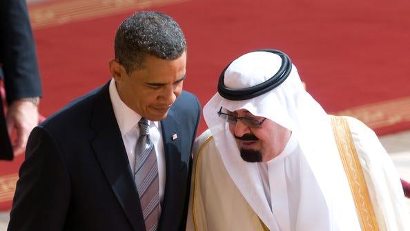 President Obama speaks with Saudi King Abdullah bin Abdul Aziz al-Saud at the King Khaled international airport in Riyadh on June 3, 2009.