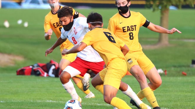 Holland's Abraham Arellano fights up the field against Zeeland East earlier this season.