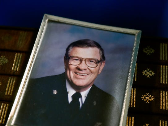 An undated photo shows Tom Landis Jr. in his firefighter