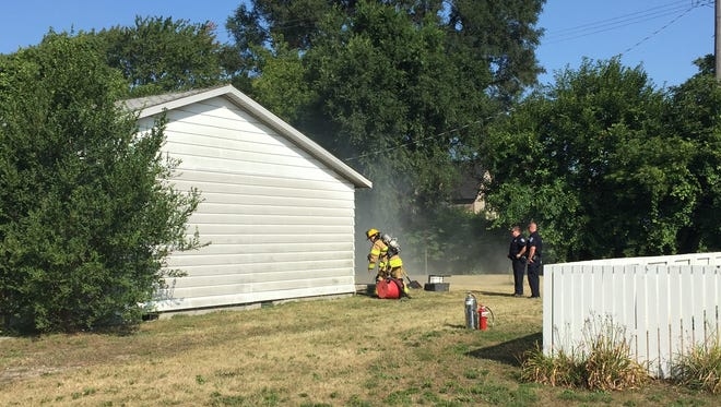 Port Huron firefighters and police officers were at the scene of a smoldering fire at 809 Griswold