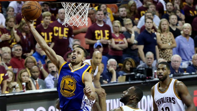 Golden State Warriors guard Stephen Curry (30) shoots the ball against Cleveland Cavaliers forward LeBron James (23) in Game 4 of the NBA Finals.