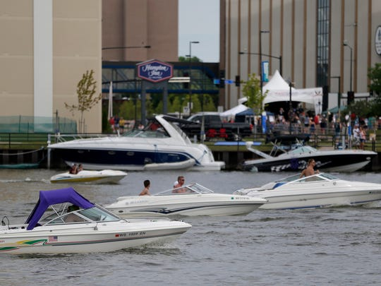 Many pleasure craft cruised the river near Leicht Park during the Fire Over the Fox festival in Green Bay July 4, 2016.