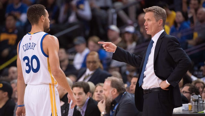 Golden State Warriors head coach Steve Kerr (right) instructs guard Stephen Curry (30) during the second quarter against the Miami Heat at Oracle Arena.