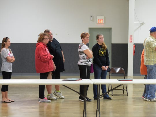 Voters, including Mary Jo Thomas and Savannah Thomas, center,  cast their ballots Saturday, Oct. 29, 2016 at the Kuhlman Center at the Wayne County Fairgrounds in Richmond.