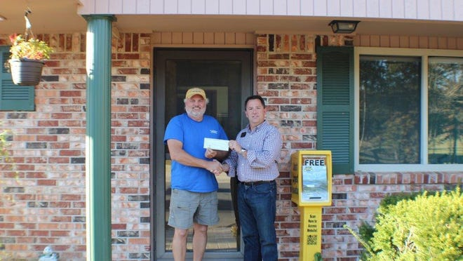 Gary Stubenfoll, right, Beaman Realty principal broker and owner, presents $3,800 to Steve Eastwold to help fund the annual John Eastwold July 4th Fireworks over Bull Shoals Lake. Since 1973, the fireworks which were initiated by the late John Eastwold, have been viewed by thousands of visitors and residents each year. It is the oldest continuous fireworks display in the Twin Lakes Area. For many years, the Beaman Realty team has assisted in collecting donations to fund the event and is well on its way to meeting the $4,000 goal in collections it set this year.