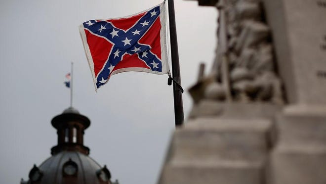The Confederate flag flies in front of the South Carolina Statehouse. Delaware NAACP President Richard Smith said no government should wave the banner of the Confederacy.