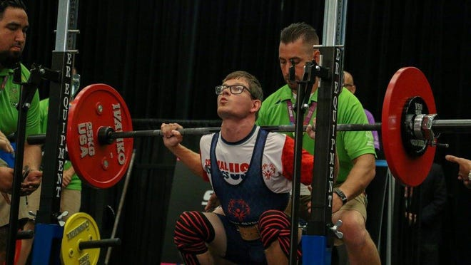 Canton's Ben Bednarz gets set to do a power-packed squat at the Special Olympics World Games.