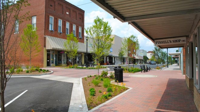 The sidewalks, lights and other pedestrian amenities pictured on Main Street in downtown Dickson are part of the ongoing downtown revitalization work.