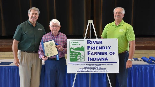 Don Black (center) is honored as a River-Friendly Farmer by Ted McKinney (left), ISDA Director, and Randy Kron (right), Indiana Farm Bureau President.