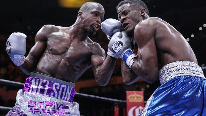 Willie Nelson catches Tony Harrison with a left uppercut Saturday night en route to a knockout victory (Photo: Lucas Noonan, PBC