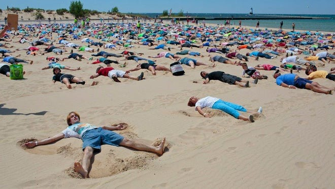 Michael Schmelter of Canton, Mich. was one of 1,414 participate in the Guinness World Record attempt for simultaneously making sand angels at Stearns Park Beach on Saturday, June 10, 2017 in Ludinton, Mich.