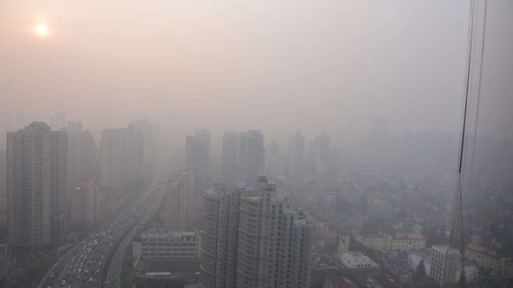 Traffic in downtown Shanghai during a period of heavy pollution. (Peter Parks, AFP/Getty Images)