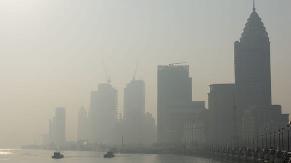 The Lujiazui Financial District and Huangpu River are engulfed in smog on December 29, 2014 in Shanghai, China.  (ChinaFoto Press/Getty Images)
