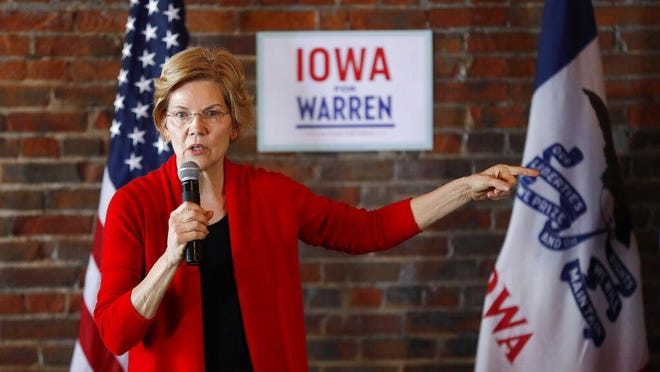 """In this March 1, 2019, file photo, Democratic presidential candidate Sen. Elizabeth Warren speaks to local residents during an organizing event in Dubuque, Iowa. On Wednesday Warren promised to break up big agricultural businesses to end their """"stranglehold"""" over farmers and mount an antitrust challenge to reverse the merger of Bayer AG with seed and biotechnology company Monsanto."""