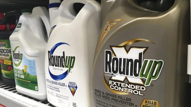 In this Feb. 24, 2019, file photo, containers of Roundup are displayed on a store shelf in San Francisco. The Environmental Protection Agency is reaffirming that a popular weed killer is safe for users, even as legal claims mount from people who blame the herbicide for their cancer.