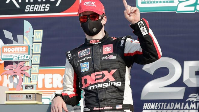 Harrison Burton celebrates after winning a NASCAR Xfinity Series auto race Saturday, June 13, 2020, in Homestead, Fla.