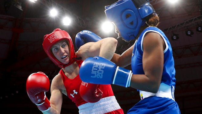 From Aug. 2, 2019, Ingrit Valencia, right, of Colombia and Virginia Fuchs, of the United States compete in the women's flyweight boxing final bout at the Pan American Games in Lima, Peru. U.S. Olympic team boxer Fuchs will face no punishment for failing a doping test after the U.S. Anti-Doping Association determined the violation had been caused by two substances transmitted by her boyfriend through sex. USADA announced its ruling Thursday, June 11, 2020, clearing the 32-year-old Fuchs, who intends to qualify for the Tokyo Olympics next year as a flyweight.
