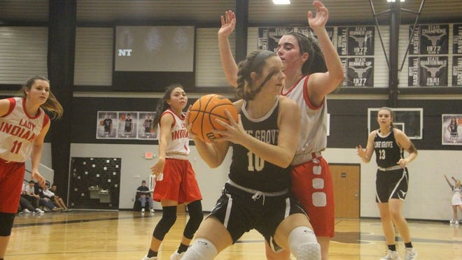 Lone Grove's Tinley Vance looks to make a pass on the baseline during the first half Thursday night against the Plainview JV at the Longhorn Invitational.