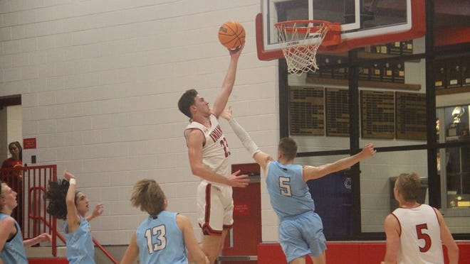 Plainview's Blake Nowell goes up for a layup in transition during the first half Tuesday night against the OKC Storm at the Plainview Activity Center.