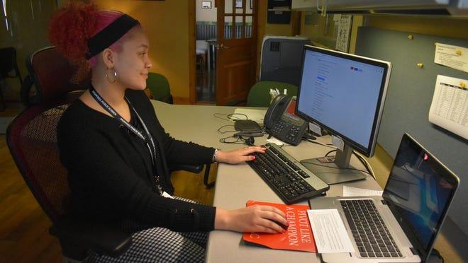 Shawnee High School student Juliana Mills working at her internship at Dennis Morris State Farm Insurance Agency.