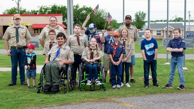 Several members of the community and local Cub Scout and Boy Scout troops celebrated Memorial Day weekend by laying out flags and wreaths at various cemeteries.