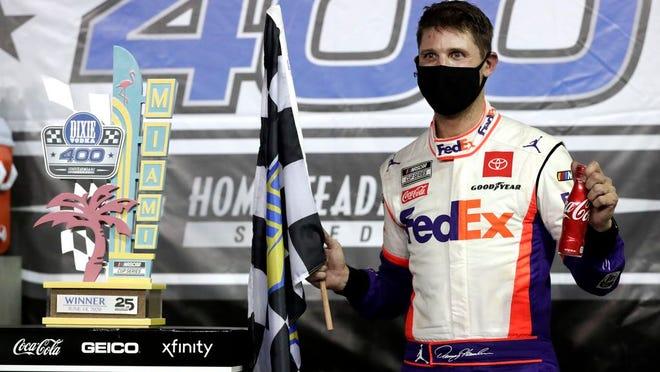 Denny Hamlin celebrates after winning a NASCAR Cup Series race in Homestead, Fla. WILFREDO LEE/AP