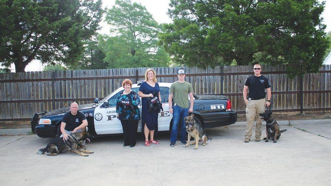 APD handlers and their K-9s received new identifying vests July, 2018 from American Nation Bank through Heroes with Hope. APD officer Cody Garrett and Lucky (left), officer Dylan Davis and Ragnar (center) and officer Jared Johnson and Boss (right) were presented with the new vests and patches by American Nation Bank Vice President Cathy Alexander (middle, left) and Heroes with Hope director Melissa Woolly (middle, right).