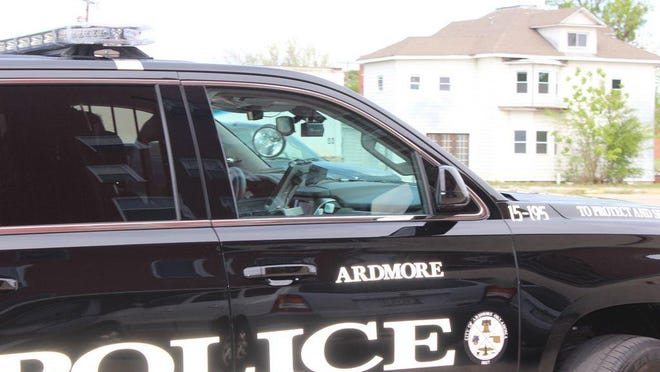 Ardmore police patrol downtown Ardmore. Authorities believe rumors about required paperwork to leave home may have originated online but say the rumors are false.