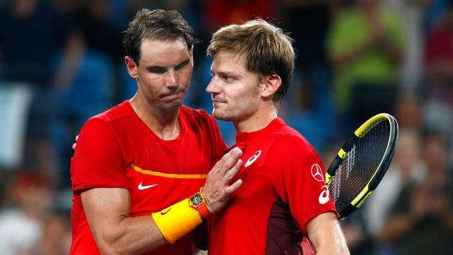 David Goffin, right, of Belgium reacts after winning over Rafael Nadal of Spain during their ATP Cup tennis match in Sydney, Friday, Jan. 10, 2020.