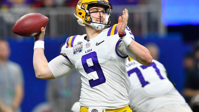 FILE - In this Dec. 28, 2019, file photo, LSU quarterback Joe Burrow (9) works against Oklahoma during the first half of the Peach Bowl NCAA semifinal college football playoff game, in Atlanta. LSU's Joe Burrow and Justin Jefferson were easy selections for The Associated Press all-bowl team. The two connected for four first-half touchdowns in a College Football Playoff semifinal blowout of Oklahoma.