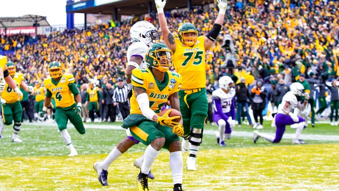 North Dakota State wide receiver Phoenix Sproles (11) smiles after scoring a touchdown during the first half of the FCS championship NCAA college football game against James Madison, Saturday, Jan. 11, 2020, in Frisco, Texas.
