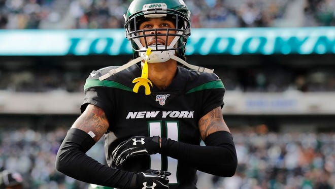 New York Jets wide receiver Robby Anderson (11) reacts after scoring a touchdown in the second quarter of an NFL football game against the Miami Dolphins, Sunday, Dec. 8, 2019, in East Rutherford, N.J.