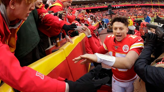 Kansas City Chiefs quarterback Patrick Mahomes (15) celebrates with fans after an NFL football game against the Los Angeles Chargers, Sunday, Dec. 29, 2019, in Kansas City, Mo.