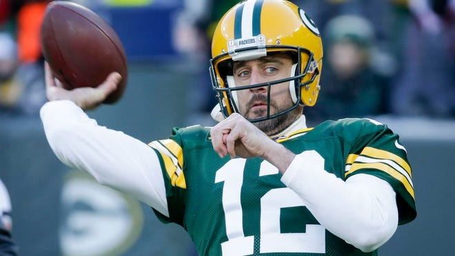 Green Bay Packers' Aaron Rodgers warms up before an NFL football game against the Chicago Bears Sunday, Dec. 15, 2019, in Green Bay, Wis.