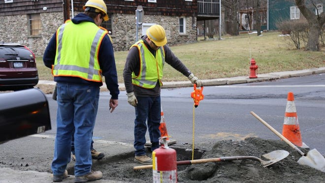 Workers at the scene of a gas leak Friday at the intersection of Luna Lane and Union Street  in Montgomery.