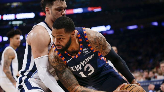 Memphis Grizzlies' Dillon Brooks, left, defends against New York Knicks' Marcus Morris Sr. during the first half of an NBA basketball game Wednesday, Jan. 29, 2020, in New York.