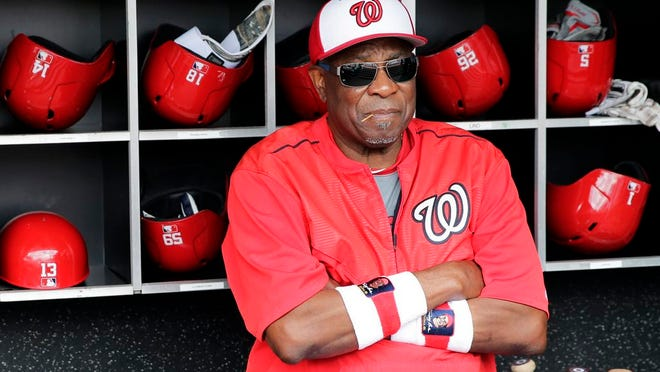 From July 8, 2017, Washington Nationals manager Dusty Baker watches batting practice before a baseball game against the Atlanta Braves in Washington.  A person with knowledge of the negotiations said Tuesday, Jan. 28, 2020, that Baker, 70,  is working to finalize an agreement to become manager of the Houston Astros. The person spoke on condition of anonymity because the deal has not yet been completed.
