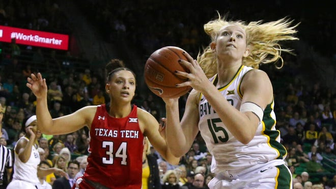 Baylor forward Lauren Cox, right, scores past Texas Tech guard Lexi Gordon, left, in the second half of an NCAA college basketball game, Saturday, Jan. 25, 2020, in Waco Texas. Baylor won 87-79.