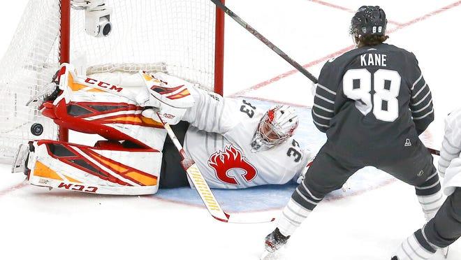 Calgary Flames goalie David Rittich (33) blocks a shot against Chicago Blackhawks forward Patrick Kane (88) during an NHL All-Star semifinal game, Saturday, Jan. 25, 2020, in St. Louis.