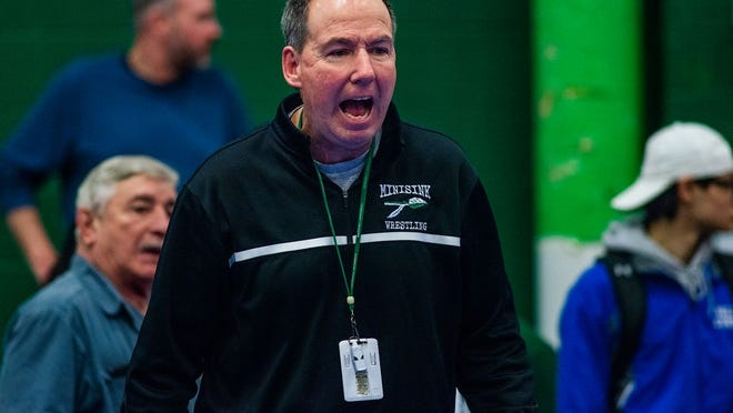 Minsiink Valley wrestling coach Kevin Gallagher joined an exclusive club with his 500th career dual-meet victory Friday.