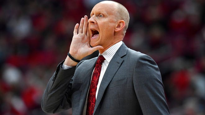 Louisville head coach Chris Mack shouts instructions to his team during the first half of an NCAA college basketball game in Louisville, Ky., Wednesday, Jan. 22, 2020.