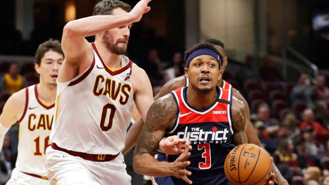 Washington Wizards' Bradley Beal (3) drives past Cleveland Cavaliers' Kevin Love (0) in the second half of an NBA basketball game, Thursday, Jan. 23, 2020, in Cleveland. Washington won 124-112.
