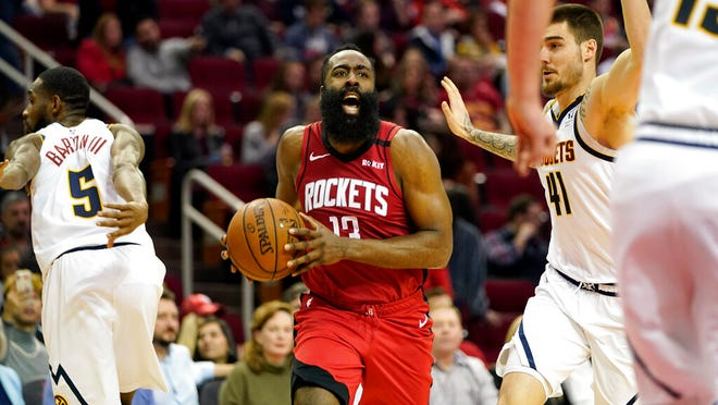 Houston Rockets' James Harden (13) reacts after being fouled by Denver Nuggets' Will Barton (5) during the second half of an NBA basketball game Wednesday, Jan. 22, 2020, in Houston. The Rockets won 121-105.