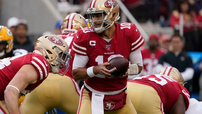San Francisco 49ers quarterback Jimmy Garoppolo (10) hands off during the first half of the NFL NFC Championship football game against the Green Bay Packers Sunday, Jan. 19, 2020, in Santa Clara, Calif.