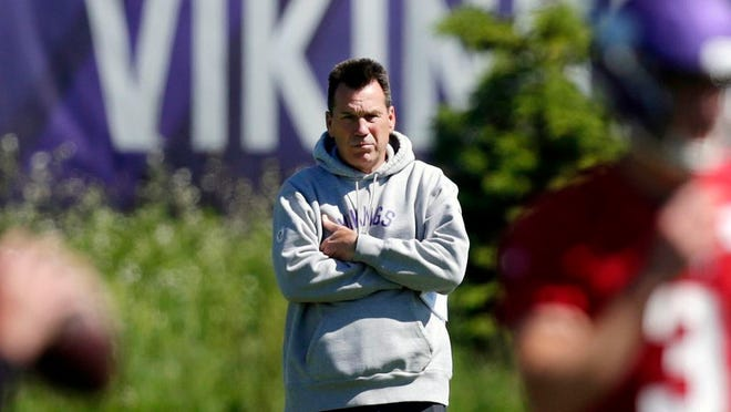 FILE - In this June 13, 2019, file photo, Minnesota Vikings assistant head coach and offensive advisor Gary Kubiak watches quarterbacks during drills at the team's NFL football training facility in Eagan, Minn. The Vikings have chosen Kubiak as their offensive coordinator. He fills the vacancy created by Kevin Stefanski's departure to become head coach of the Cleveland Browns. The widely expected move was confirmed by a person with knowledge of the decision. The person spoke to The Associated Press on condition of anonymity because the club had not yet made the announcement. The 58-year-old Kubiak served as offensive adviser and assistant to head coach Mike Zimmer this season.