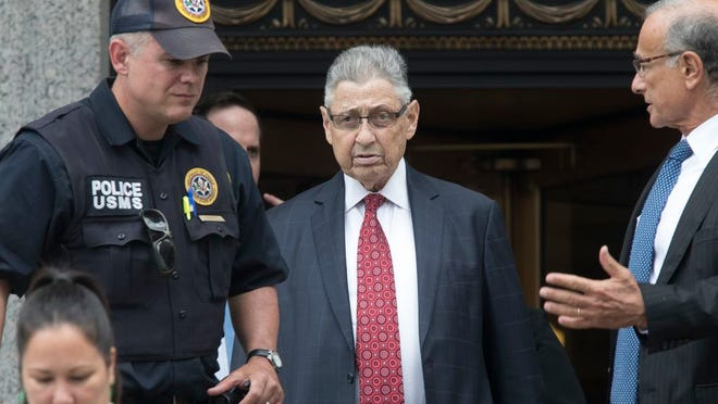 FILE - In this July 27, 2018 file photo, former New York Assembly Speaker Sheldon Silver, center, leaves federal court in New York after his sentencing. Federal appeals court judge Peter Hall said Tuesday, Sept. 25 that Silver might not have to report to prison until a judicial panel decides if he can remain free on bail while he appeals.  Silver was sentenced to seven years in prison after he was convicted earlier this year of accepting nearly $4 million in return for legislative favors.