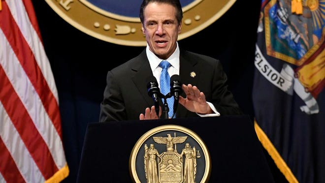 FILE - In this Jan. 8, 2020, file photo, New York Gov. Andrew Cuomo delivers his State of the State address at the Empire State Plaza Convention Center, in Albany, N.Y.  Cuomo faces a Tuesday, Jan. 21, 2020 deadline to release a budget proposal expected to address a looming $6 billion deficit fueled by soaring Medicaid costs.