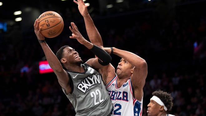 Brooklyn Nets guard Caris LeVert (22) goes to the basket against Philadelphia 76ers center Al Horford (42) during the second half of an NBA basketball game, Monday, Jan. 20, 2020, in New York. The 76ers won 117-111.